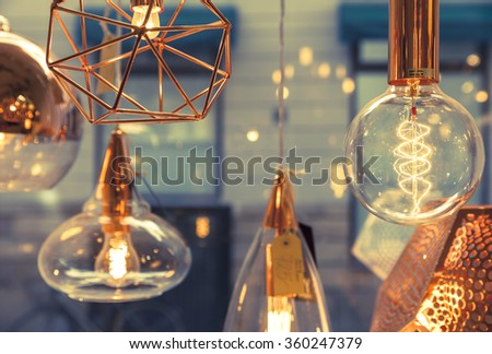 Closeup of several bulbs seeing their tungsten filaments #360247379