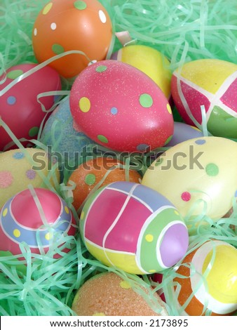 Closeup of several Easter eggs over green artifial grass.