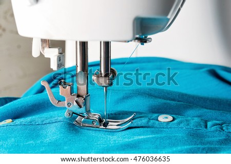 Closeup of sewing machine with blue cloth #476036635