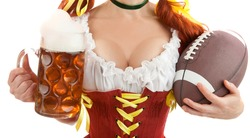 Closeup of Sexy Woman Wearing a Traditional Oktoberfest Costume with Beer Glass and American Football. Isolated on White Background