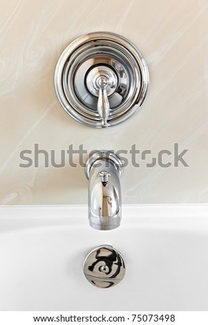 Closeup of shiny chrome bathtub tap fixture