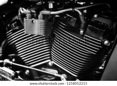 Closeup of shiny chromed motorcycle engine with cylinder fins #1258052215