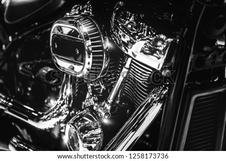 Closeup of shiny chromed motorcycle engine with cylinder fins #1258173736