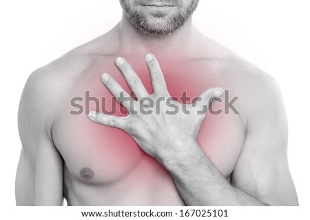 Closeup of shirtless bearded muscular Caucasian man with chest pain pressing hand on chest on white background