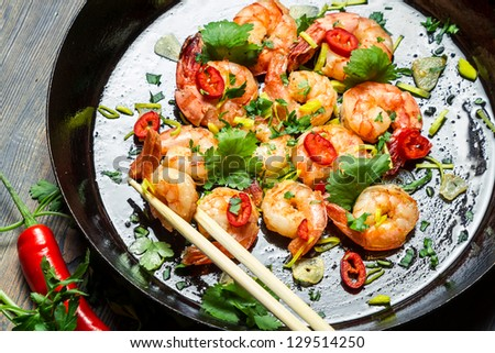 Closeup of shrimps sauteed with chilli pepper