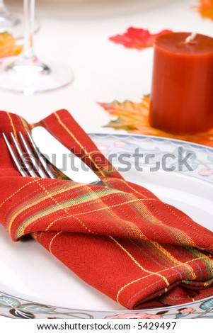 Closeup of silverware for fall festive theme dinner table arrangement