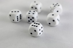 closeup of six white dices with black spots