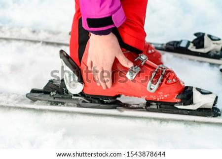 Closeup of skis closeup on human leg.
