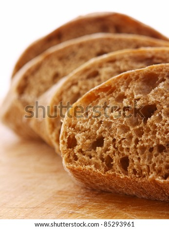 Closeup of sliced bread on a chopping board