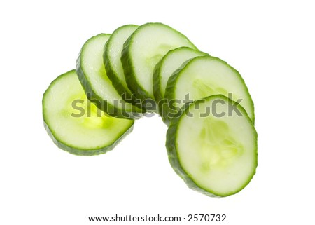 Closeup of slices of cucumber isolated on white background