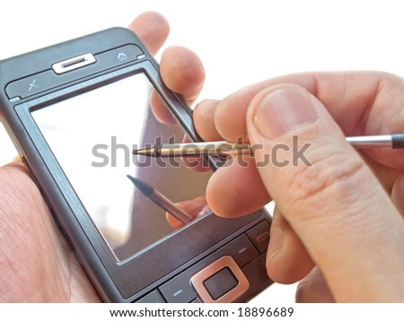 closeup of smartphone in hand isolated on white