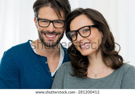 Closeup of smiling couple wearing spectacle