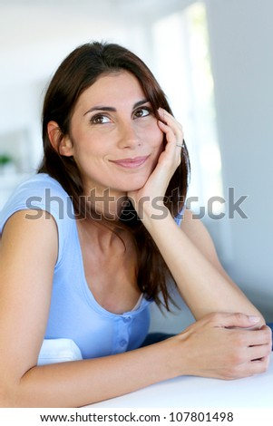 Closeup of smiling girl with satisfied look on her face