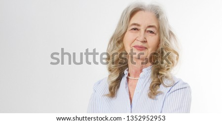 Closeup of smiling senior woman wrinkle face and gray hair. Old mature lady touching her wrinkled skin isolated on white background. Copy space. Banner