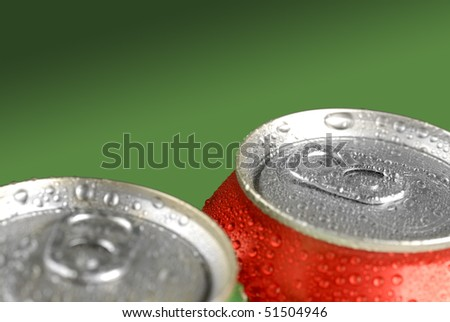 Closeup of soda or pop cans with drops of water for fresshness
