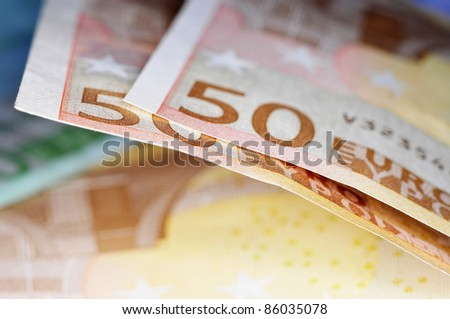 closeup of some 50 and 100 euro bills