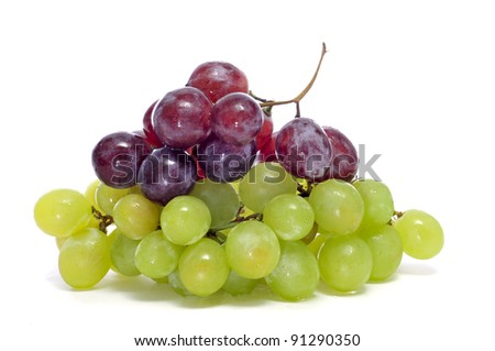 closeup of some bunchs of grapes on a white background