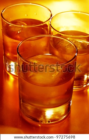 closeup of some glasses with mixed drinks in a club