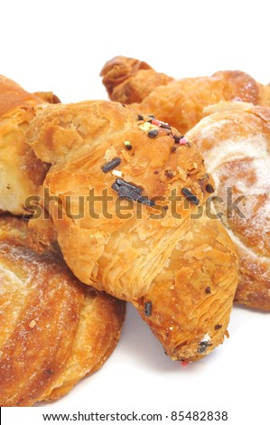 closeup of some pastries, as chocolate croissants and ensaimadas