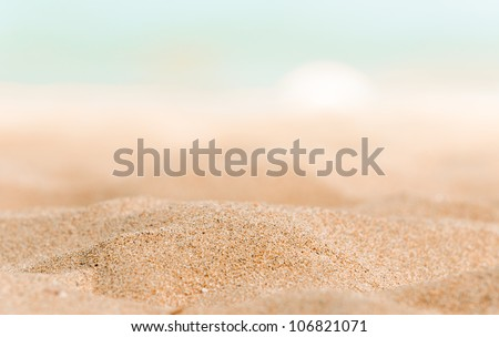 Closeup of some sand on the shore - stock photo