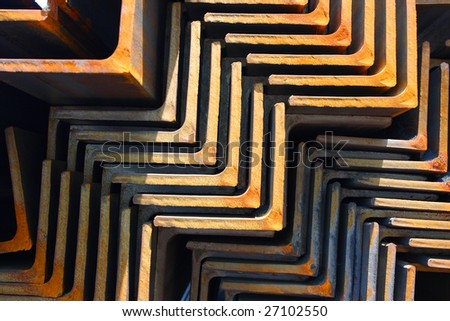 Closeup of steel angles bunch in warehouse - stock photo