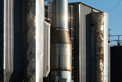 closeup of steel equipment, tanks, storage, containers, structures at a brewery factory concept beer industry in South Africa