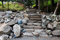 Closeup of stepping stone stairs up to a natural area