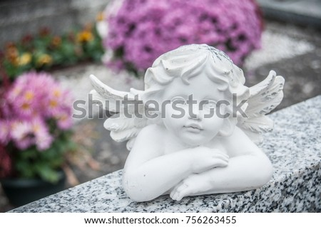 closeup of stoned angel at cemetery