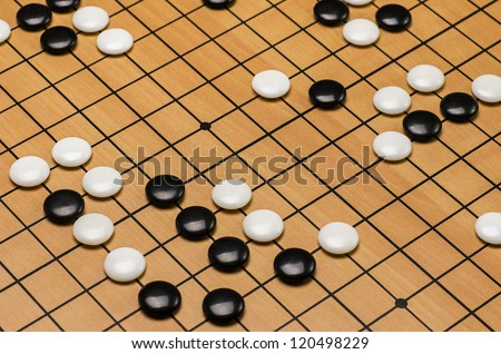 closeup of stones on a Go board
