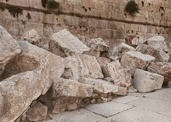 closeup of stones thrown from the second temple to the street below after the destruction of the temple in 70 CE