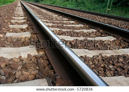Closeup of straight railway tracks from low angle