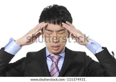 Closeup of stressed business man rubbing temples