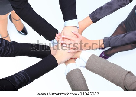 Closeup of successful business women with their hands together