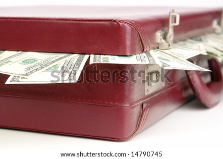 Closeup of suitcase with protruding american dollar banknotes
