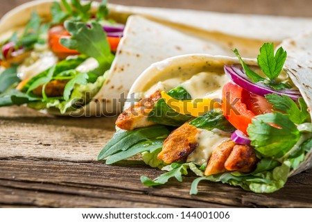 Closeup of tasty kebab with vegetables and chicken