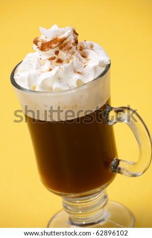 Closeup of tasty Sambuca Coffee Cocktail, Sambuca liquor, Kahlua, coffee and whipped cream - Coffee Warmers series