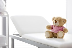 Closeup of teddybear on bed at hospital