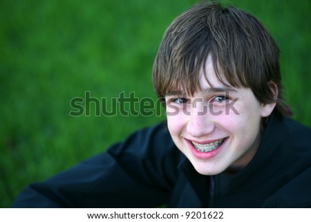 stock photo : closeup of teen boy with braces smiling. Save to a lightbox ▼