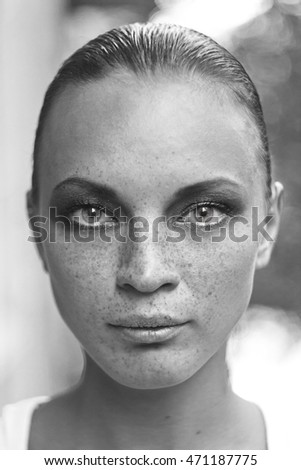 Closeup of teenage girl's face with freckles outdoor #471187775