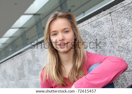 Closeup of teenage girl sitting on a school bench