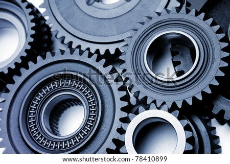 Closeup of teeth of steel gears meshing together
