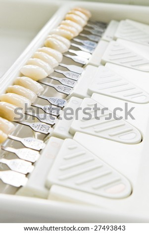 closeup of teeth shades dental tool