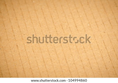Closeup of textured recycled cardboard with natural fiber parts
