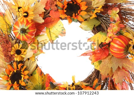 Closeup of thanksgiving wreath over white