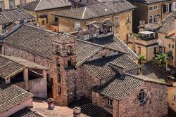 Closeup of the ancient Suffrage Church in Lucca downtown (Chiesa del Suffragio or dei Santi Maurizio e Lazzaro, 1634) from the Guinigi Tower, XIV century, Tuscany, Italy, Europe.