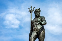 Closeup of the bronze statue of Neptune (1566), Roman God, fountain in Piazza del Nettuno, Bologna, Emilia-Romagna, Italy, Europe. Artist Giambologna (1529-1608)