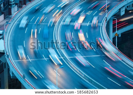 closeup of the curve lanes with car motion blur #185682653