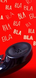 closeup of the handset of a black telephone in a red background and the text bla bla bla, in a vertical format to use for mobile stories or as smartphone wallpaper