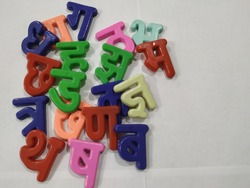 Closeup of the Hindi language alphabet, the letters are 3D for the children to easily grasp the basic shape of the letter. Hindi is the official language of India. It is spoken by millions.