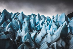 Closeup of the jagged edges that showcase the gorgeous blue details of a glacier.